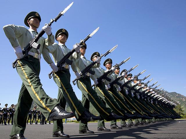 Chinese troops practice marching ahead of a September 3 military parade at a camp on the outskirts of Beijing. China is ramping up publicity for its World War II military parade featuring 12,000 soldiers and 500 pieces of military equipment. (AP Photo/Ng Han Guan)