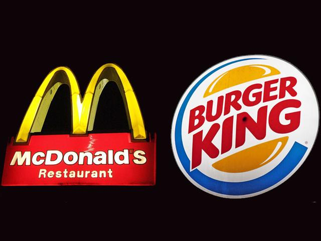 Combination of the logos for fast food giants McDonalds and Burger King. (AFP File Photo)