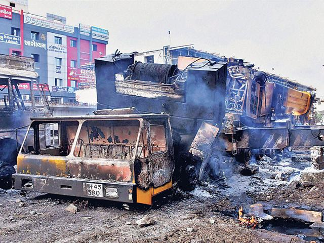 Scene of destruction after the protest by Patels in Surat on Wednesday. (PTI Photo)