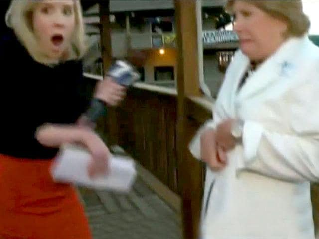 This TV video frame grab courtesy of WDBJ7-TV in Roanoke, Virginia shows Alison Parker (L) the moment shots ring out during an interview on tourism with Vicki Gardner, the local chamber of commerce director, before she was shot and killed. Police are looking for a suspect who apparently opened fire on WDBJ7's photographer Adam Ward and reporter Alison Parker. (AFP Photo)