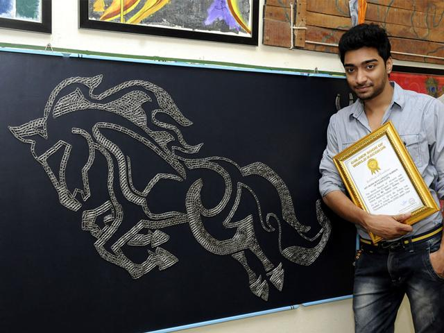 Indore boy Sameer Dubey entered the Golden Book of World Records by making a horse sculpture using 2,069 paperclips. (Shankar Mourya/HT)