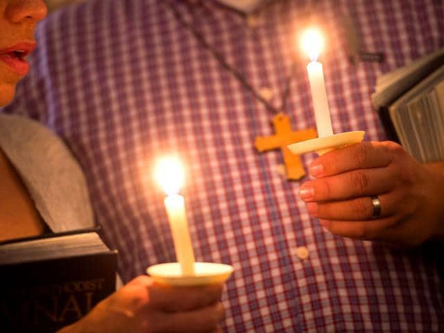 Community supporters light candles during a vigil for journalists Alison Parker and Adam Ward who were killed during a shooting in Moneta. Vester Lee Flanagan is blamed for the killings. (AP Photo)