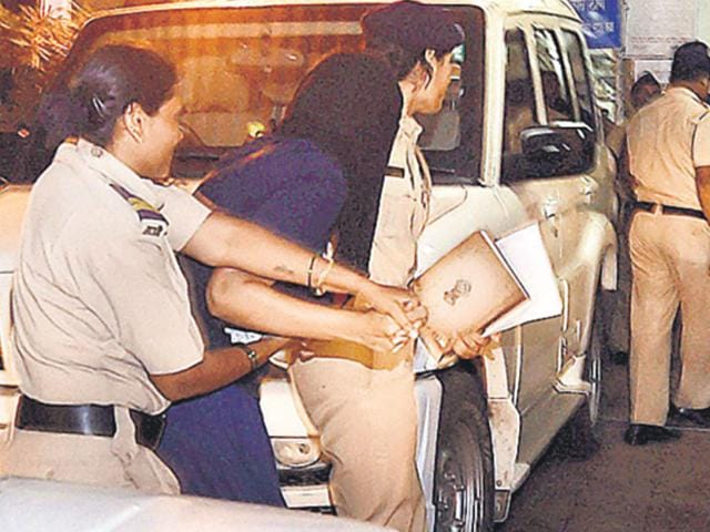 Indrani Mukerjea being brought to Khar police station in Mumbai on Saturday. (Kunal Patil/HT Photo)