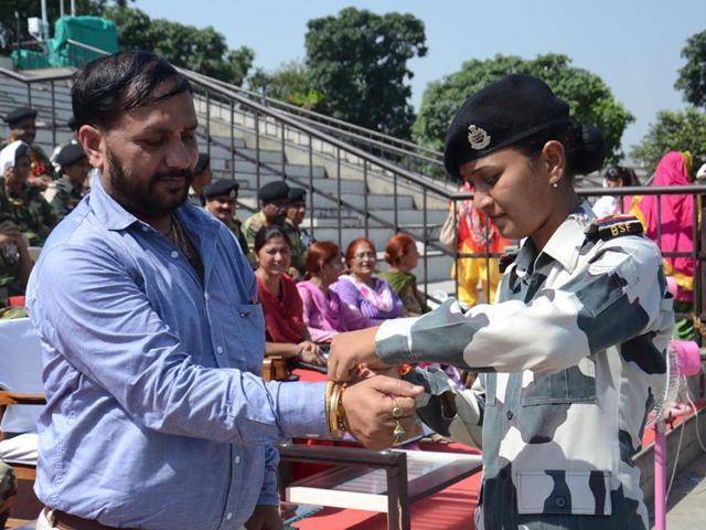 A Border Security Force woman jawan celebrating Raksha Bandhan at Wagah border in Amritsar on Saturday. Sameer Sehgal/HT