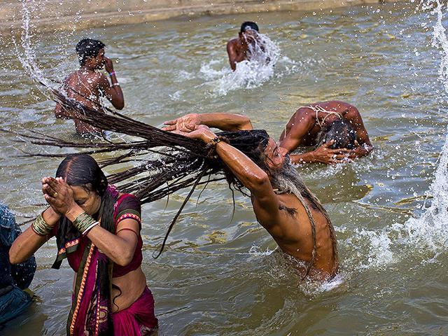 Hindu devotes take a bath in the Godavari River during Kumbh Mela in Nasik, Saturday, Aug. 29, 2015. (AP Photo)