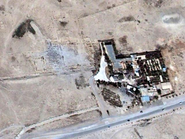 A handout image taken on August 27, 2015 and provided on August 28, 2015 by UNITAR-UNOSAT shows a close-up of a satellite-detected image of rubble and surrounding columns at the location of the Baal Shamin temple (C) in Syria's ancient city of Palmyra. Satellite images confirm the destruction of the Baal Shamin temple in Palmyra, the United Nations said, after international condemnation of the act claimed by the Islamic State group. (AFP Photo/UNITAR-UNOSAT)