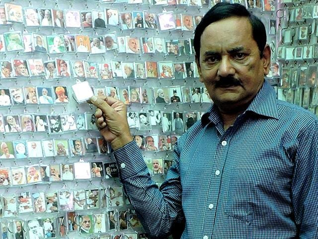 62-old-year-old Rakesh Vaid with his collection of key rings. (HT Photo)
