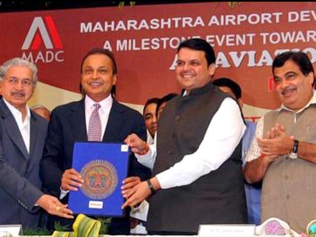 Maharashtra CM Devendra Fadnavis handing over the allotment letter of 289 acres of land in Nagpur's Mihan SEZ for Dhirubhai Ambani Aerospace Park (DAAP) to the chairman of Reliance Group, Anil Ambani. (Photo source: Twitter/Dev_Fadnavis)