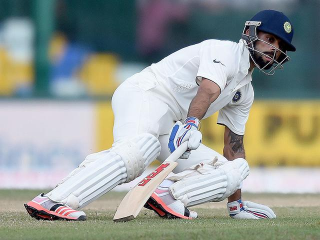 Indian Test skipper Virat Kohli runs between the wickets during the third day of the third and final Test match against Sri Lanka at the Sinhalese Sports Club (SSC) in Colombo, on August 30, 2015. (AFP Photo)