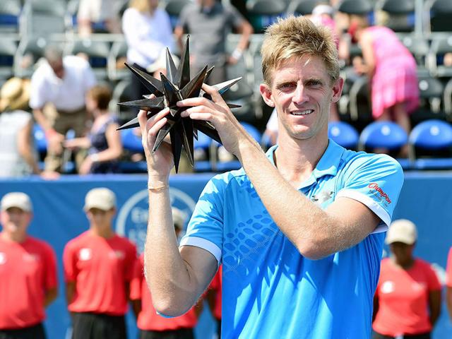 Kevin Anderson of South Africa poses with the trophy after defeating Pierre-Hugues Herbert of France during the men's final of the Winston-Salem Open at Winston-Salem, North Carolina, on August 29, 2015. (AFP Photo)