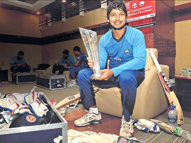 Kumar Sangakkara with the 2014 World Twenty20 trophy.