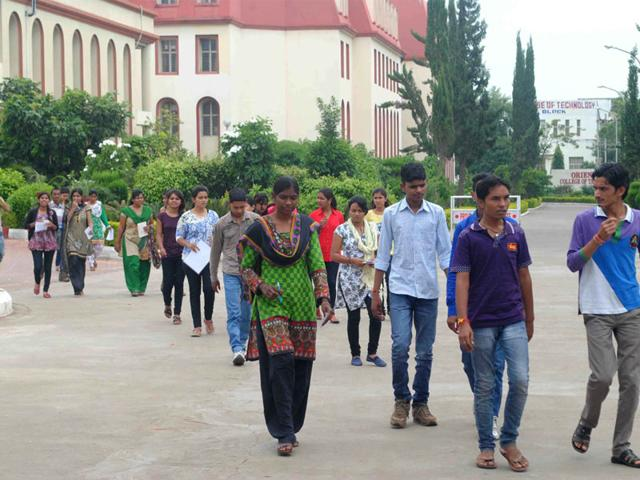 Candidates coming out of an exam centre after taking PAHUNT exam in Bhopal on Sunday. (HT photo)