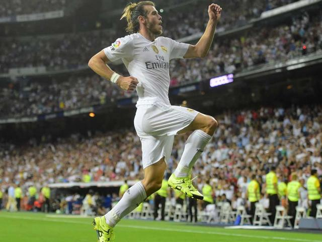 Real Madrid's Welsh forward Gareth Bale celebrates scoring his second goal during the La Liga match against Real Betis at the Santiago Bernabeu stadium in Madrid, on August 29, 2015. (AFP Photo)