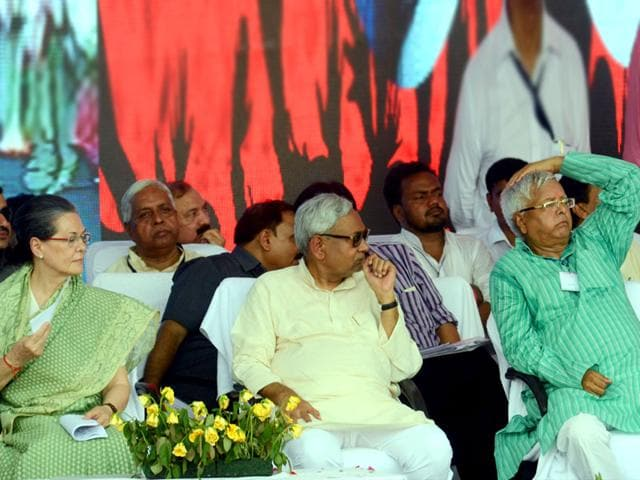 Congress president Sonia Gandhi with Bihar chief minister Nitish Kumar and RJD chief Lalu Prasad during the Swabhiman rally at Gandhi Maidan, in Patna. (Santosh Kumar/HT Photo)