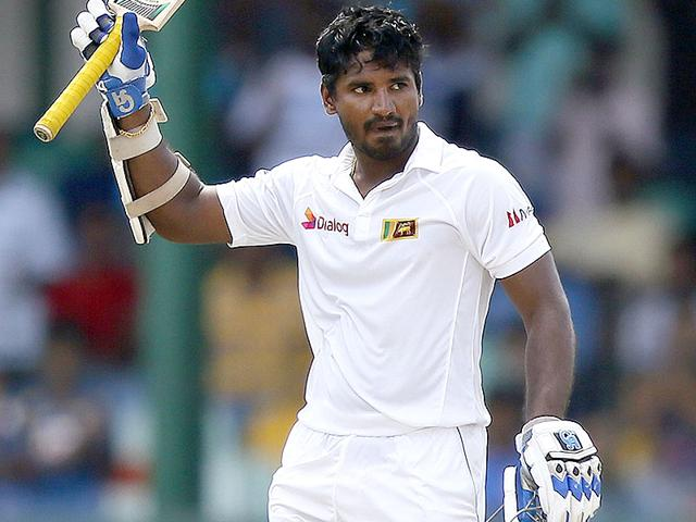 Sri Lanka's debutant wicketkeeper Kusal Perera celebrates scoring his half-century in the first innings of the third Test. (Reuters Photo)