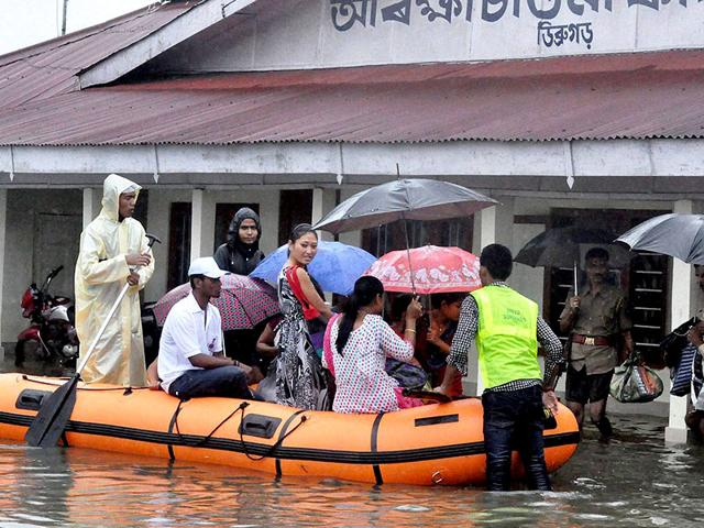 Rescue and relief operation in progress during the floods in Dibrugarh. (PTI Photo)