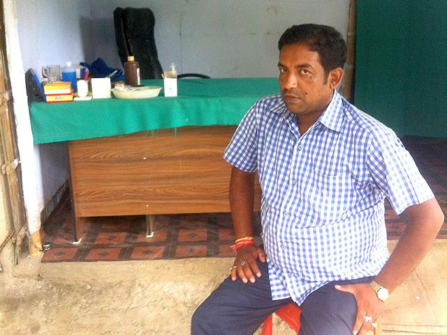 Amresh Kumar sits in front of his rural clinic in Samastipur. He is unhappy with Nitish Kumar but will vote for him because of caste. (Prashant Jha/HT Photo)