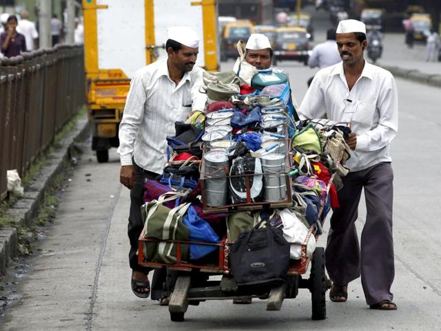 Mumbai's famed dabbawalas pick up meals every morning that have been cooked in their clients' homes and deliver them to their offices by afternoon. (HT file photo)