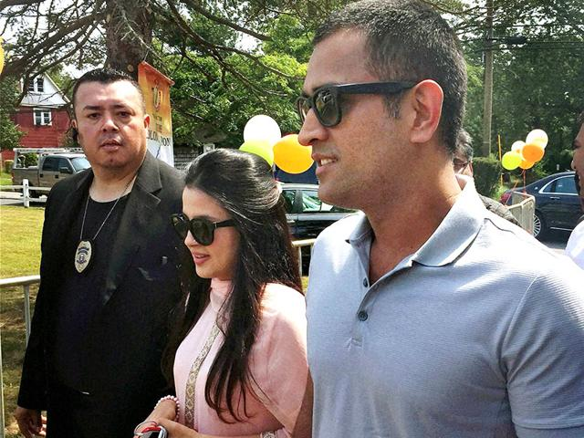 Indian cricketer Mahendra Singh Dhoni with wife Sakshi arrives at Sidhhivinayak Temple in New Jersey on Sunday. (PTI Photo)