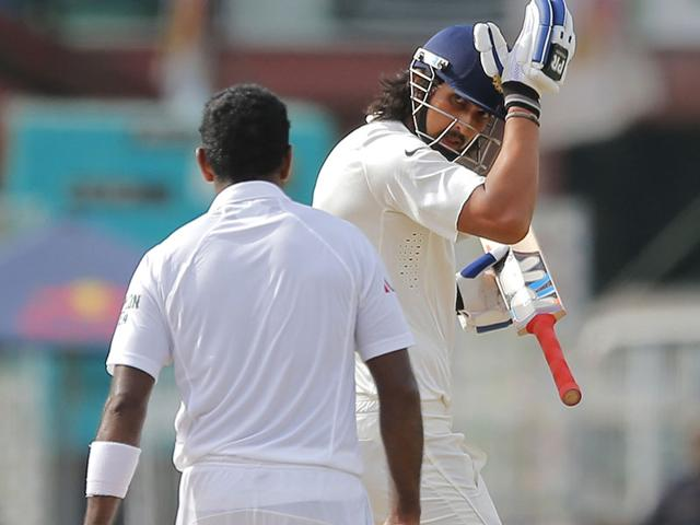 Sri Lankan bowler Dhammika Prasad and India's Ishant Sharma exchange words on day four of the third Test match in Colombo. (AP Photo)