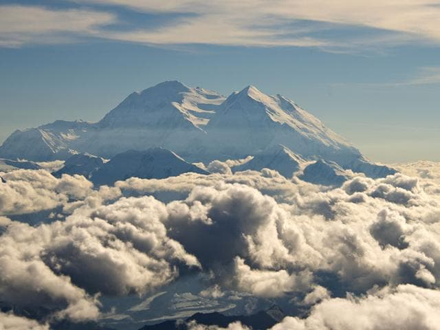 An aerial photo provided by Holland America Line, Mount McKinley pierces through the clouds above Denali National Park and Preserve in Alaska. (Holland America Line via AP)