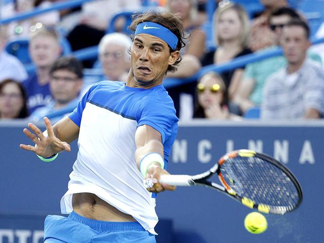 Rafael Nadal, of Spain, returns to Feliciano Lopez, of Spain, during a match at the Western and Southern Open tennis tournament. (AP file photo)