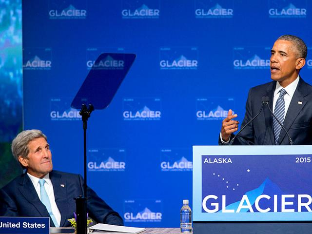 US President Barack Obama (R) accompanied by secretary of state John Kerry (L) speaks at the Global Leadership in the Arctic: Cooperation, Innovation, Engagement and Resilience (GLACIER) Conference at Dena'ina Civic and Convention Center in Anchorage, Alaska. (AP Photo)