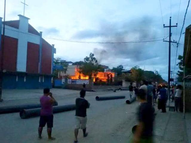 A vehicle is set on fire during a protest in Manipur on Tuesday. Rioters set fire to the homes of seven lawmakers during a rampage to protest new legislation defining who can claim to be from the northeastern state, police said on Tuesday. (AP Photo)