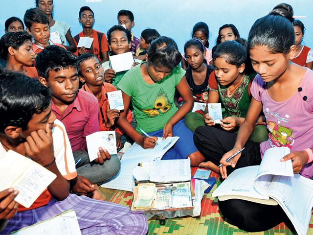 Opened in 2014 and managed entirely by children, the bank now has 130 accounts of children aged between 9 and 18 years in its Ranchi branch in slums of Jagannathpur. (HT Photo)