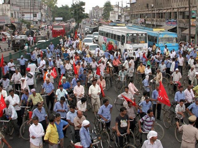 Trade union members blocked traffic outside the bus-stand road in Ludhiana on Wednesday. (JS Grewal/HT)