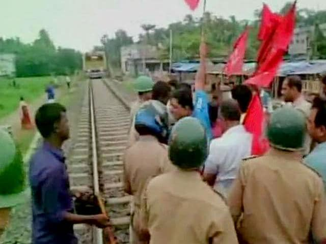 Protesters block a railway track in North 24-Parganas district in West Bengal. A nation-wide strike was called by trade unions on Wednesday to protest aganist the proposed labour reforms by central and state government. (Image via Twitter, @ANI_news)