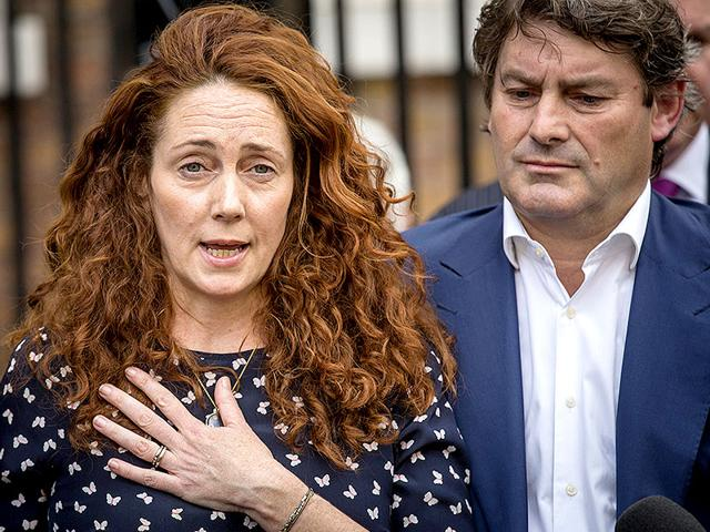 File photo of Former News International chief executive Rebekah Brooks and her husband Charlie Brooks outside their home in London. (Getty Images)