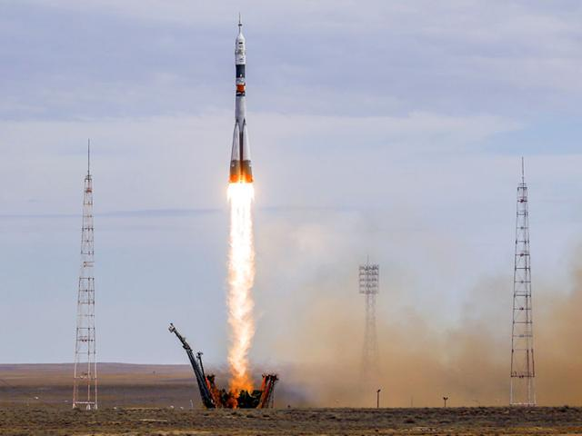 The Soyuz TMA-18M spacecraft carrying the crew of Aidyn Aimbetov of Kazakhstan, Sergei Volkov of Russia and Andreas Mogensen of Denmark blasts off from the launch pad at the Baikonur cosmodrome, Kazakhstan. (Reuters Photo)