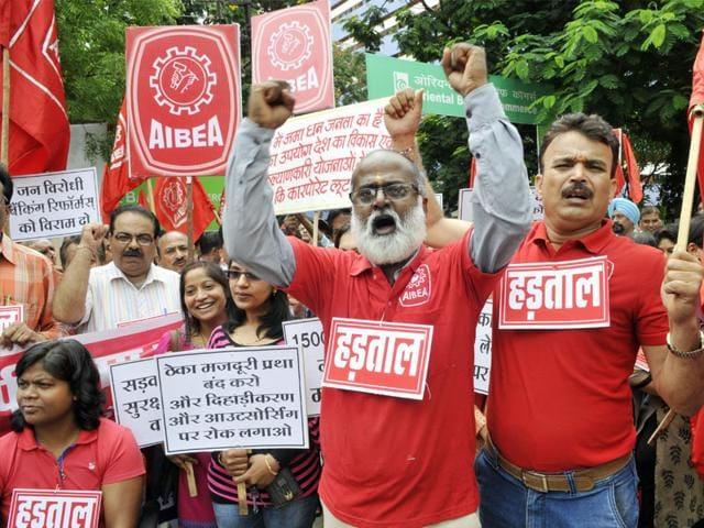 Trade union members stage a demonstration in Bhopal. (Praveen Bajpai/HT Photo)