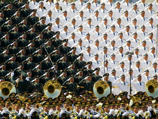 Military band sing and salute at the Tiananmen Square at the beginning of the military parade marking the 70th anniversary of the end of World War Two, in Beijing, China. (Reuters Photo)