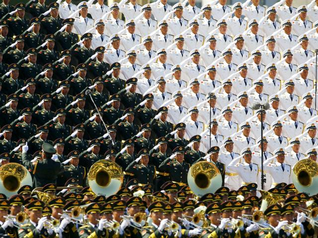 China flaunts military might, says will cut forces by 300,000