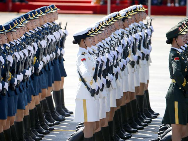 Chinese female military personnel march during the parade. The spectacle involved more than 12,000 troops, 500 pieces of military hardware and 200 aircraft of various types, representing what military officials say is the Chinese military's most cutting-edge technology. (AP Photo)