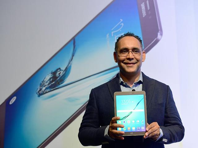 Manu Sharma, director of product marketing at Samsung India, poses with Samsung's newly-launched slimmest tablet the Galaxy Tab S2 in Bangalore. Photo: AFP