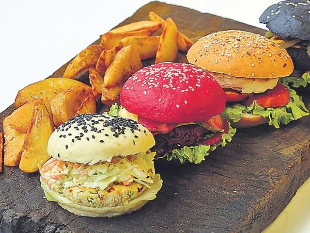 As the trend of red, black and white burgers catches on, we look at how they are made and ask experts what they think about it. (HT Photo)