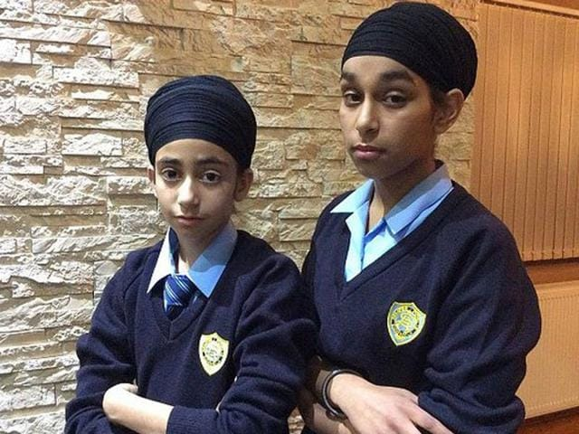 Simranjot Kaur, 13, and Prasimran Kaur, 11, both baptised Khalsa Sikhs refused to remove the headwear which can be worn by both sexes in Sikhism. (Credits: SikhNet)