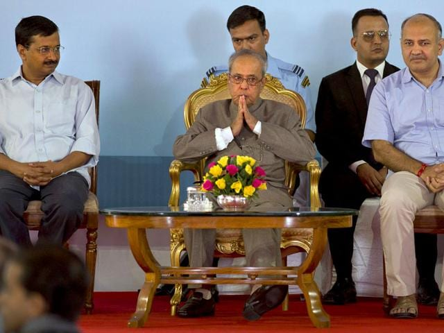 President Pranab Mukherjee, center, sits with Delhi chief minister Arvind Kejriwal, left, and education minister of Delhi Manish Sisodia, right, during a function to mark Teachers' Day in New Delhi. September 5 is marked as Teachers' Day in India. (Photo/AP)