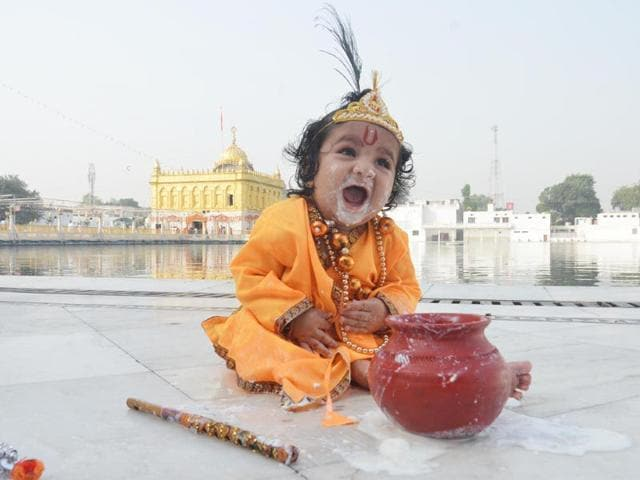 A child dressed as Lord Krishna while members of Yadav community took out a procession on Janmashtami in Indore on Saturday. (Arun Mondhe/HT photo)