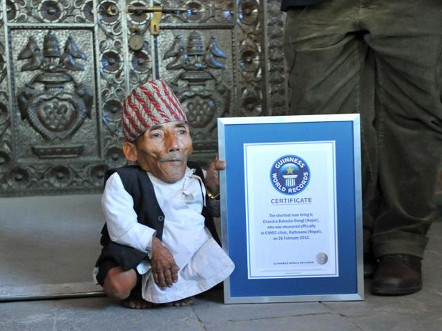 Chandra Bahadur Dangi from Kathmandu with his Guinness World Record certificate after being declared the world's shortest man at 54.6cm (21.5 inches) tall. (AFP Photo/Prakash Mathema)