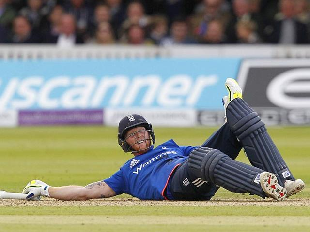 England's Ben Stokes lies on the grass after hitting a ball thrown by Australia's Mitchell Starc away with his hand during the second ODI at Lord's in London, on September 5, 2015. Stokes was consequently given out for 'obstructing the field'. (AFP Photo)
