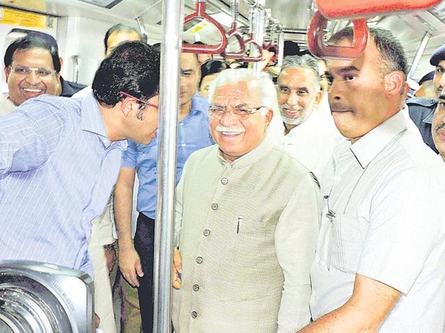 Haryana CM Manohar Lal Khattar rides the Badarpur-Faridabad metro, a day before its inauguration on Saturday. (PTI Photo)