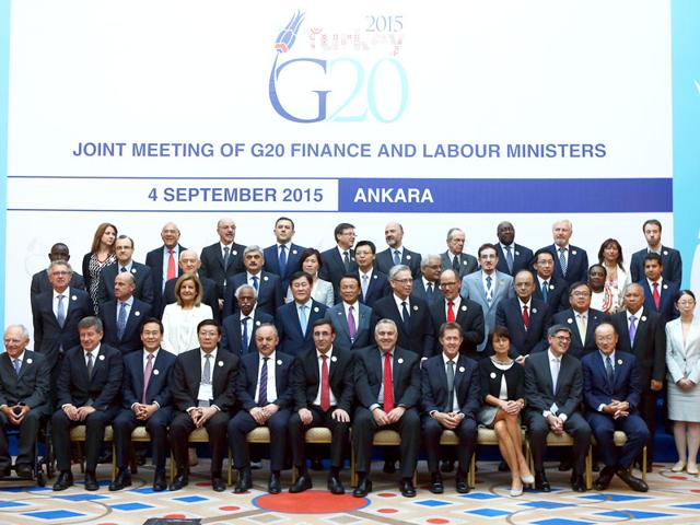 Turkey's economy minister Cevdet Yilmaz (6th L) and labour and social security minister Ahmet Erdem (5th L) pose for a family photo with finance ministers and central bank chiefs from the world's top 20 economies during the first of day of a two-day G20 meeting of finance ministers and central bank governors in Ankara. (AFP Photo)