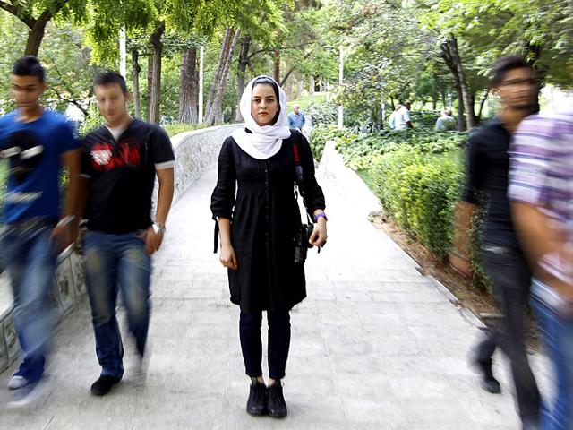 File picture of Iranian photographer Newsha Tavakolian posing for an image in a park, in Tehran. The Iranian photographer won the Netherlands' Principal Prince Claus Award and announced plans to donate almost half of her prize. (AFP Photo)