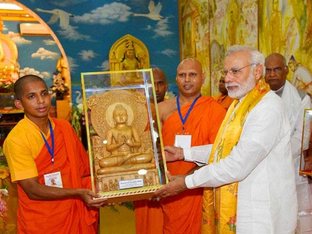Prime Minister Narendra Modi being presented a memento by monks at a temple in Bodh Gaya on Saturday. (PTI Photo)