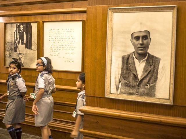Children walk past a photograph of Jawaharlal Nehru at the Nehru Memorial Museum in Delhi. (Abhishek Saha/HT Photo)