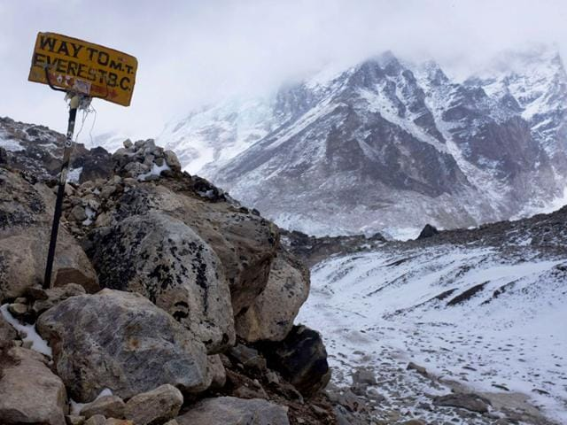 A sign shows the way to Everest Base Camp high in the Khumbu Glacier, one day after an earthquake-triggered avalanche swept through parts of the base camp killing scores of people (AFP File Photo)